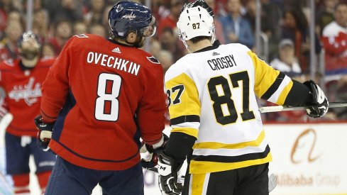 Sidney Crosby and Alex Ovechkin talk with referee Wes McCauley
