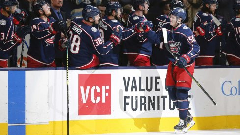 Dec 16, 2019; Columbus, OH, USA; Columbus Blue Jackets left wing Eric Robinson (50) celebrates a goal against the Washington Capitals during the first period at Nationwide Arena.