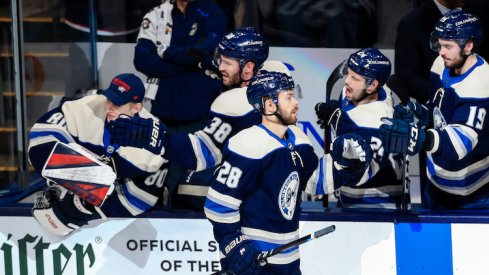 Columbus Blue Jackets right wing Oliver Bjorkstrand (28) celebrates with teammates on the bench after scoring a goal against the Tampa Bay Lightning in the second period at Nationwide Arena