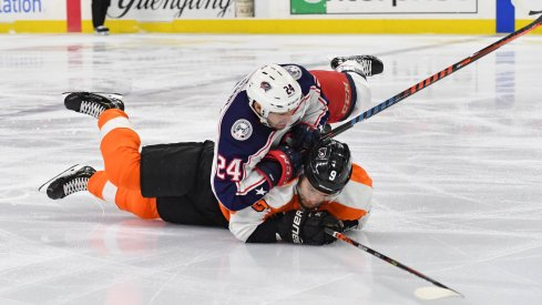 Feb 18, 2020; Philadelphia, Pennsylvania, USA; Philadelphia Flyers defenseman Ivan Provorov (9) and Columbus Blue Jackets center Nathan Gerbe (24) get tangled up during the first period during the first period at Wells Fargo Center.