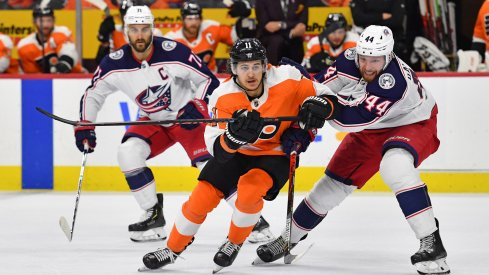 Feb 18, 2020; Philadelphia, Pennsylvania, USA; Philadelphia Flyers right wing Travis Konecny (11) and Columbus Blue Jackets defenseman Vladislav Gavrikov (44) battle for the puck during the second period during the first period at Wells Fargo Center.