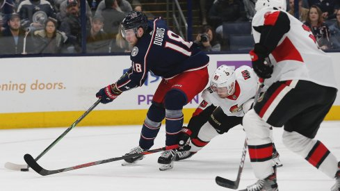 Nov 25, 2019; Columbus, OH, USA; Columbus Blue Jackets center Pierre-Luc Dubois (18) carries the puck as Ottawa Senators right wing Mikkel Boedker (89) tries to poke check during the second period at Nationwide Arena.