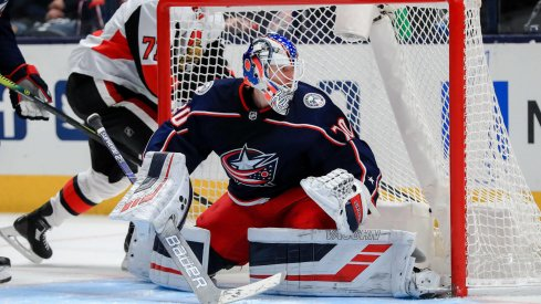 Feb 24, 2020; Columbus, Ohio, USA; Columbus Blue Jackets goaltender Joonas Korpisalo (70) follows the puck in play against the Ottawa Senators in the second period at Nationwide Arena. Mandatory Credit: Aaron Doster-USA TODAY Sports