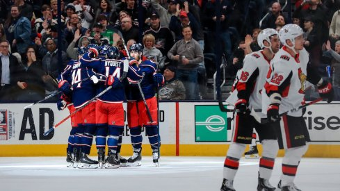 Columbus Blue Jackets left wing Nick Foligno (back) celebrates with teammates after scoring his second goal of the game against the Ottawa Senators in the second period at Nationwide Arena.