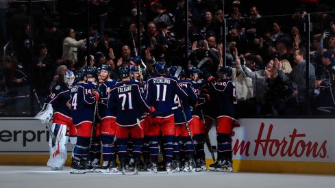 Feb 24, 2020; Columbus, Ohio, USA; The Columbus Blue Jackets bench reacts as center Emil Bemstrom (not pictured) scores the game winning against the Ottawa Senators in the overtime period at Nationwide Arena.