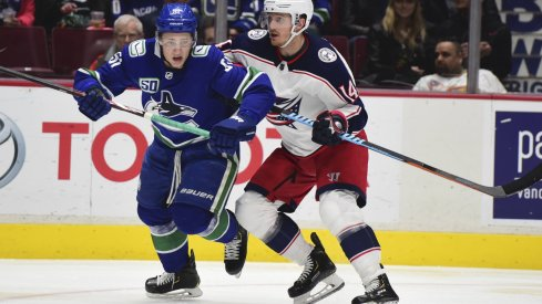 Mar 8, 2020; Vancouver, British Columbia, CAN; Vancouver Canucks defenseman Troy Stecher (51) skates against Columbus Blue Jackets forward Gustav Nyquist (14) during the second period at Rogers Arena.