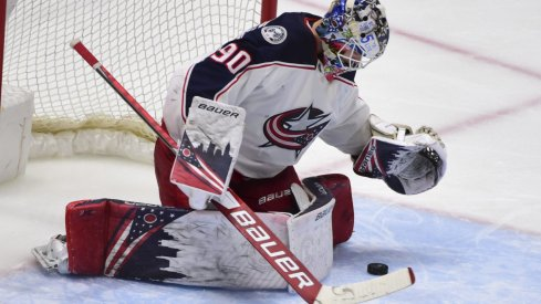 Columbus Blue Jackets goaltender Elvis Merzlikins (90) blocks a shot on net by the Vancouver Canucks during the third period at Rogers Arena.