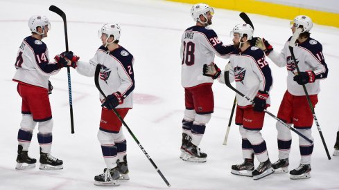 The Columbus Blue Jackets celebrate the win against the Vancouver Canucks during the third period at Rogers Arena.