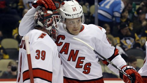 Carolina Hurricanes goaltender Alex Nedeljkovic (39) and defenseman Jake Gardiner (51) celebrate after defeating the Pittsburgh Penguins at PPG PAINTS Arena. The Hurricanes won 6-2.
