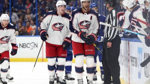 Apr 10, 2019; Tampa, FL, USA; Columbus Blue Jackets defenseman Seth Jones (3) celebrates with teammates after scoring the game winning goal against the Tampa Bay Lightning during the third period of game one of the first round of the 2019 Stanley Cup Playoffs at Amalie Arena.