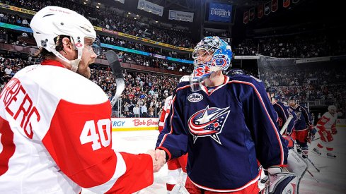 Steve Mason shakes Henrik Zetterberg's hand after the Columbus Blue Jackets were swept by the Detroit Red Wins in the 2009 Stanley Cup Playoffs.