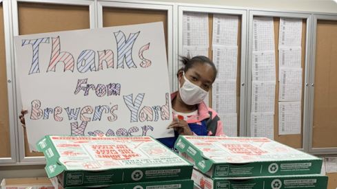 Employees at the Brewer's Yard Kroger in Columbus thank Columbus Blue Jackets forwards Pierre-Luc Dubois and Oliver Bjorkstrand for a pizza donation.