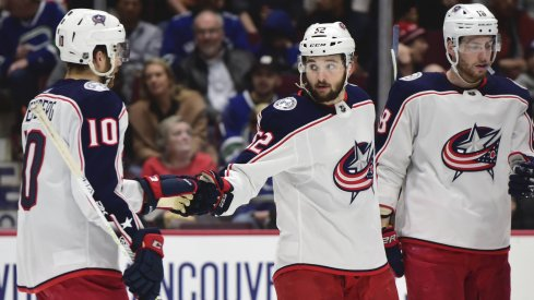 Columbus Blue Jackets forward Emil Bemstrom (52) celebrates his goal against Vancouver Canucks goaltender Thatcher Demko (35) (not pictured) with Columbus Blue Jackets forward Alexander Wennberg (10) during the second period at Rogers Arena.