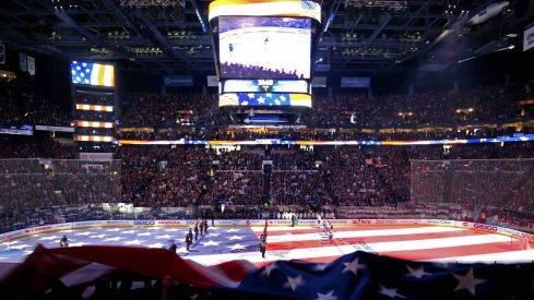 A view of the Tampa Bay Lightning and the Columbus Blue Jackets starters as an American flag is passed over the crowd during the national anthem prior to game three of the first round of the 2019 Stanley Cup Playoffs at Nationwide Arena.