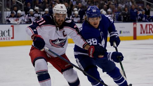 Columbus Blue Jackets forward Nick Foligno (71) and Toronto Maple Leafs forward William Nylander (88) battle for position at Scotiabank Arena. Columbus defeated Toronto in overtime.