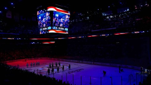 The starters for the Toronto Maple Leafs and the Columbus Blue Jackets stand on the ice for the American National Anthem prior to the game at Nationwide Arena.