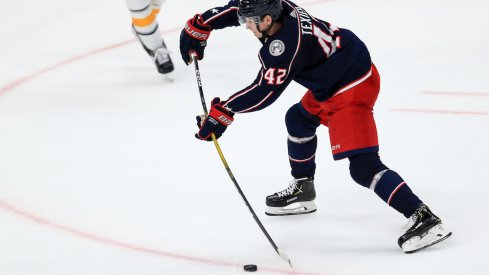 Columbus Blue Jackets center Alexandre Texier (42) skates with the puck in the third period against the Ottawa Senators at the Canadian Tire Centre.