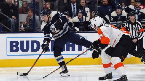 Nov 27, 2019; Columbus, OH, USA; Columbus Blue Jackets right wing Josh Anderson (77) wrists a shot on gaol as Philadelphia Flyers defenseman Ivan Provorov (9) defends during the second period at Nationwide Arena.