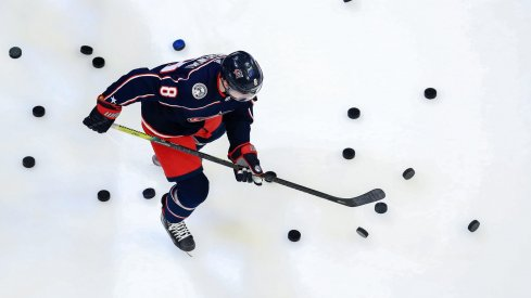 Columbus Blue Jackets defenseman Zach Werenski (8) skates on the ice during warmups prior to the game against the New York Rangers at Nationwide Arena.