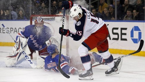 Jakob Lilja of the Columbus Blue Jackets controls the puck in front of the New York Rangers net.