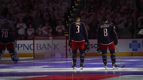 ct 12, 2019; Raleigh, NC, USA; Columbus Blue Jackets defenseman Zach Werenski (8) and Columbus Blue Jackets defenseman Seth Jones (3) looks on during the National Athem before the game against the Carolina Hurricanes at PNC Arena. The Columbus Blue Jackets defeated the Carolina Hurricanes 3-2.