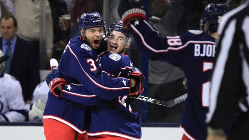 Columbus Blue Jackets defenseman Seth Jones celebrates with Alexandre Texier and Oliver Bjorkstrand after a goal scored in the Stanley Cup Playoffs.
