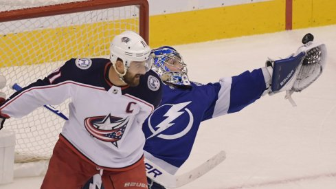 Tampa Bay Lightning goaltender Andrei Vasilevskiy (88) makes a save behind Columbus Blue Jackets left wing Nick Foligno (71) in the third overtime in game one of the first round of the 2020 Stanley Cup Playoffs at Scotiabank Arena.