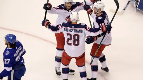 Aug 13, 2020; Toronto, Ontario, CAN; Columbus Blue Jackets right wing Oliver Bjorkstrand (28) celebrates his goal against the Tampa Bay Lightning with teammates during the first period in game two of the first round of the 2020 Stanley Cup Playoffs at Scotiabank Arena.