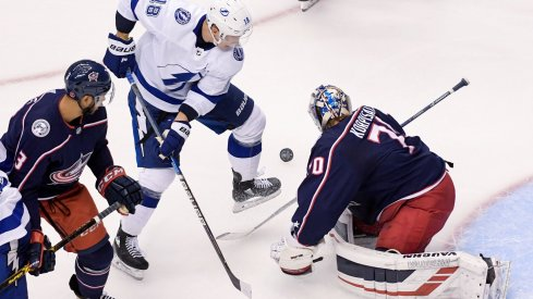 Aug 17, 2020; Toronto, Ontario, CAN; Tampa Bay Lightning left wing Ondrej Palat (18) battles against Columbus Blue Jackets goaltender Joonas Korpisalo (70) in the first period in game four of the first round of the 2020 Stanley Cup Playoffs at Scotiabank Arena.