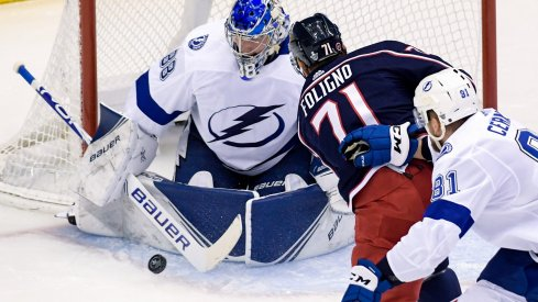Aug 17, 2020; Toronto, Ontario, CAN; Columbus Blue Jackets left wing Nick Foligno (71) attempts a shot on Tampa Bay Lightning goaltender Andrei Vasilevskiy (88) as defenseman Erik Cernak (81) trails in the first period in game four of the first round of the 2020 Stanley Cup Playoffs at Scotiabank Arena.