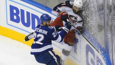 Tampa Bay Lightning defenseman Kevin Shattenkirk (22) hits Columbus Blue Jackets left wing Nick Foligno (71) during the first period in game five of the first round of the 2020 Stanley Cup Playoffs