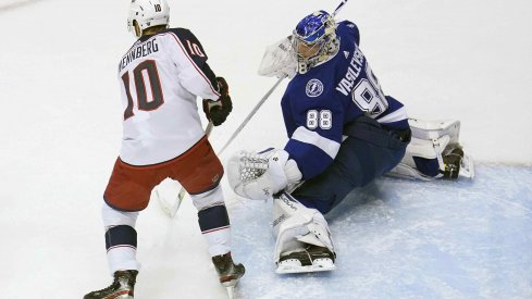 Tampa Bay Lightning goaltender Andrei Vasilevskiy (88) blocks a shot as Columbus Blue Jackets center Alexander Wennberg (10) is in position for the rebound during the first period in game five of the first round of the 2020 Stanley Cup Playoffs at Scotiabank Arena.