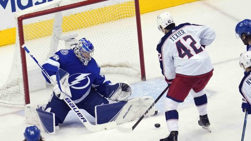 Tampa Bay Lightning goaltender Andrei Vasilevskiy (88) blocks a shot against Columbus Blue Jackets center Alexandre Texier (42) during the second period in game five of the first round of the 2020 Stanley Cup Playoffs at Scotiabank Arena.