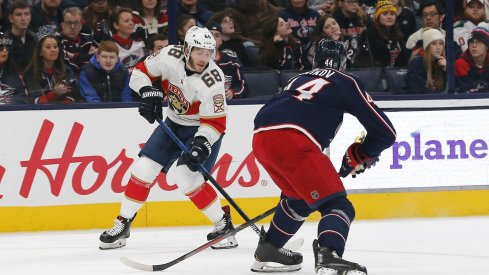 Florida Panthers left wing Mike Hoffman (68) controls the puck against Columbus Blue Jackets defenseman Vladislav Gavrikov (44) during the first period at Nationwide Arena.