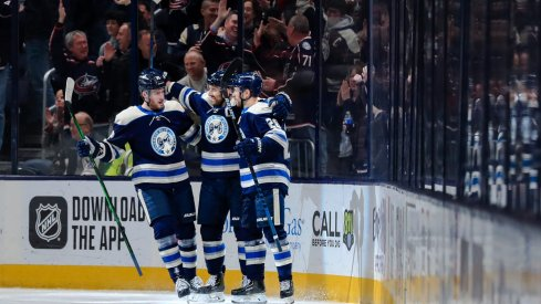 Feb 20, 2020; Columbus, Ohio, USA; Columbus Blue Jackets left wing Nick Foligno (middle) celebrates with teammate center Pierre-Luc Dubois (left) and right wing Oliver Bjorkstrand (right) after scoring a goal against the Philadelphia Flyers in the first period at Nationwide Arena.