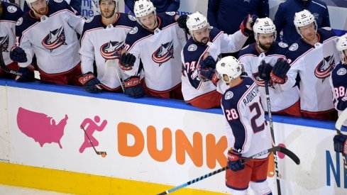 Columbus Blue Jackets right wing Oliver Bjorkstrand (28) celebrates his goal against the Tampa Bay Lightning with teammates during the first period in game two of the first round of the 2020 Stanley Cup Playoffs at Scotiabank Arena.