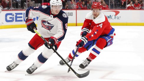 Dec 27, 2019; Washington, District of Columbia, USA; Columbus Blue Jackets defenseman Zach Werenski (8) skates with the puck as Washington Capitals right wing Richard Panik (14) defends in the first period at Capital One Arena.
