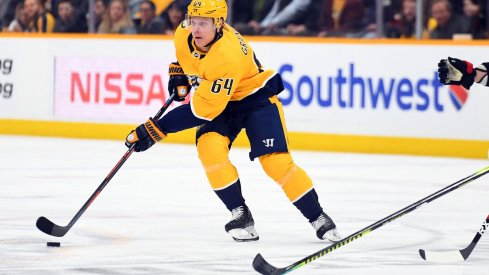 Feb 25, 2020; Nashville, Tennessee, USA; Nashville Predators center Mikael Granlund (64) skates with the puck during the first period against the Ottawa Senators at Bridgestone Arena.