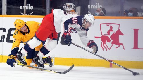 Nashville Predators center Nick Cousins (21) is called for interference on Columbus Blue Jackets defenseman Dean Kukan (46) late in the first period at Bridgestone Arena.