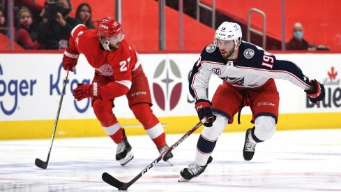 Columbus Blue Jackets center Liam Foudy (19) brings the puck up ice during the third period against the Detroit Red Wings at Little Caesars Arena.