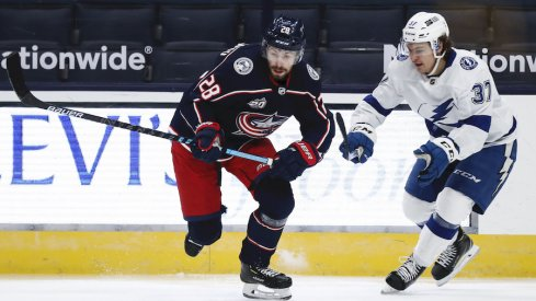 Columbus Blue Jackets right wing Oliver Bjorkstrand (28) skates against Tampa Bay Lightning center Yanni Gourde (37) in the first period at Nationwide Arena.