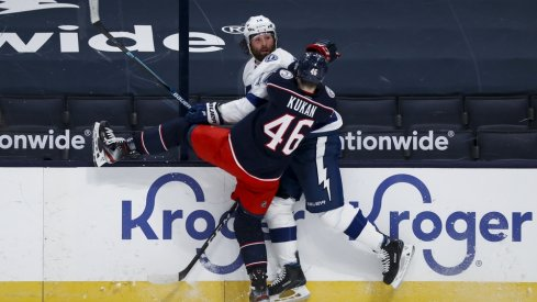 Columbus Blue Jackets defenseman Dean Kukan (46) checks Tampa Bay Lightning left wing Pat Maroon (14) in the second period at Nationwide Arena.