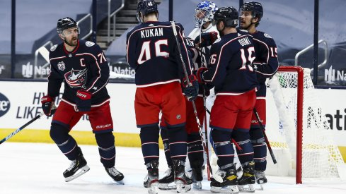 Columbus Blue Jackets left wing Nick Foligno (71) celebrates with teammates after scoring a goal against the Tampa Bay Lightning in the first period at Nationwide Arena.