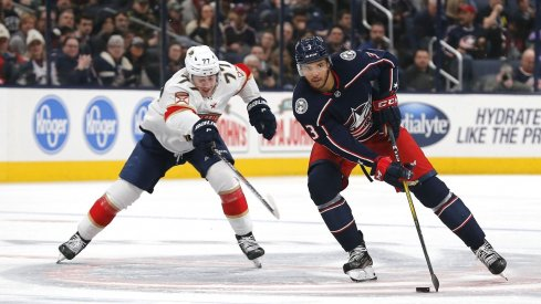 Columbus Blue Jackets defenseman Seth Jones controls the puck against Florida's Frank Vatrano.