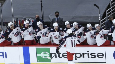 Feb 11, 2021; Chicago, Illinois, USA; Columbus Blue Jackets center Kevin Stenlund (11) celebrates his game winning goal against the Chicago Blackhawks during the third period at United Center.
