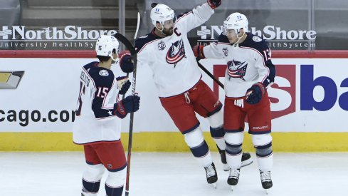 Columbus Blue Jackets right wing Cam Atkinson (13) celebrates his goal against the Chicago Blackhawks with Jackets left wing Nick Foligno (71) during the first period at United Center.
