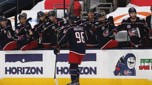 Feb 8, 2021; Columbus, Ohio, USA; Columbus Blue Jackets center Jack Roslovic (96) celebrates a goal against the Carolina Hurricanes during the third period at Nationwide Arena.
