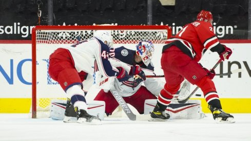 Columbus Blue Jackets goaltender Joonas Korpisalo (70) stops a shot by Carolina Hurricanes right wing Nino Niederreiter (21) during the first period at PNC Arena.