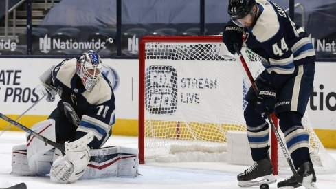 Columbus Blue Jackets defenseman Vladislav Gavrikov (44) attempts to play a rebound of a Joonas Korpisalo (70) save against the Carolina Hurricanes during the second period at Nationwide Arena.