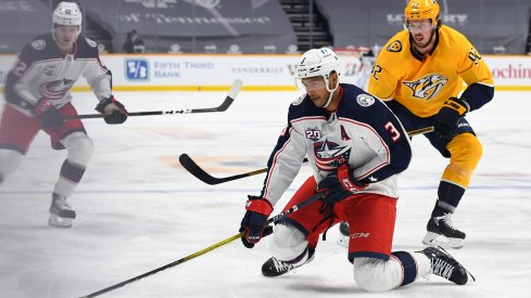 Columbus Blue Jackets defenseman Seth Jones controls the puck from his knees as he enters the offensive zone against the Nashville Predators during their first meeting of the season.